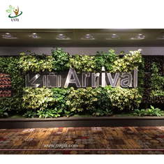 China UVG GRW033 Wedding Stage Backdrop Decoration with Fake Green Plant Wall supplier