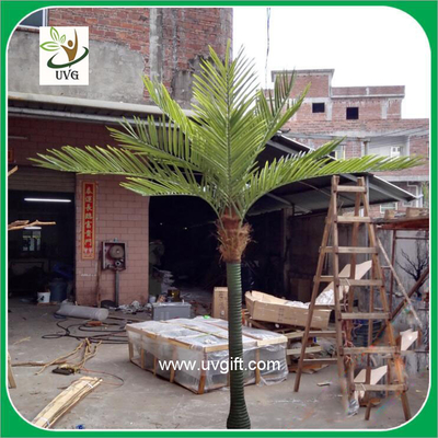 China UVG PTR021 decorative small artificial plastic palm trees for sale in dongguang factory supplier