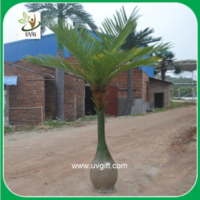 China UVG PTR020 artificial indoor decorative palm tree with unique trunk for hotel foyer decor supplier