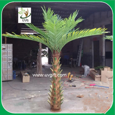 China UVG PTR027 hotel use natural bark small artificial palm tree for decor supplier