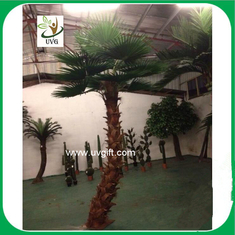 China UVG PTR034 indoor airport decoration curved trunk artificial coconut trees palm tree price supplier