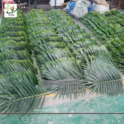 China UVG indoor cheap plastic palm tree leaves green fake leaves wholesale for party decoration PTR062 supplier