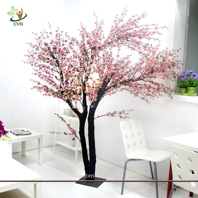 China UVG Indoor artificial peach blossom tree with pink flowers for restaurant decoration factory